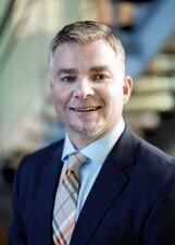 Mr. Justin G. Davis, MBA