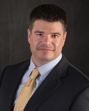 Travis J. Litscher