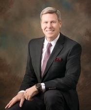 Mark L. Dickerson