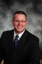Mr. Bruce E. Paulsrud