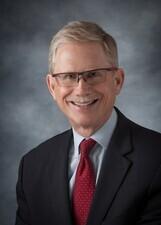 Mr. Steven L. Schou