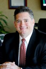 Mr. Mark G. Thompson
