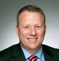 Mr. Christopher E. Kolker